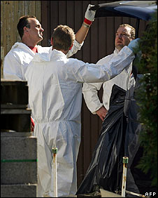 Police secure evidence in the backyard of the suspect\'s house in Amstetten