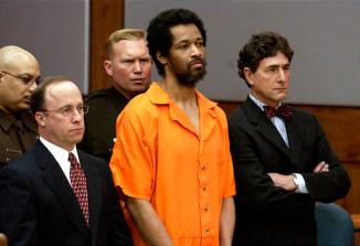 Convicted sniper John Allen Muhammad, center, stands with his attorney\'s Peter Greenspun, left, and Jonathan Shapiro as he is sentenced to death for the shooting of Dean Meyers at the Prince William County Circuit Court in Manassas, Va., in a Tuesday March 9, 2004 file photo.   (AP Photo/Steve Helber, file)
