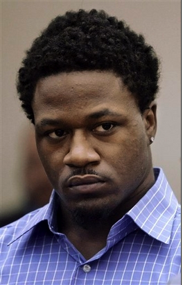 """Tennessee Titans cornerback Adam \""""Pacman\"""" Jones is shown in court in Murfreesboro, Tenn., in this Jan. 31, 2008 file photo. Jones paid \""""extortion\"""" money to a 29-year-old man arrested for a Las Vegas strip club shooting that left a club employee paralyzed, according to a police report obtained Monday, April 21, 2008. The man allegedly used go-betweens to reach Jones, who paid $15,000 in two installments after the shooting."""