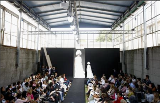 The models are strutting past and the celebrities are carefully eyeing the collections, but it\'s not at every fashion show that you see prison guards by the catwalk.