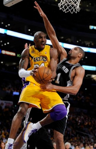 Los Angeles Lakers\' Kobe Bryant, left, passes the ball as San Antonio Spurs\' Tim Duncan defends in the second half of Game 5 of the NBA Western Conference basketball finals, Thursday, May 29, 2008 in Los Angeles. (AP Photo/Kevork Djansezian)