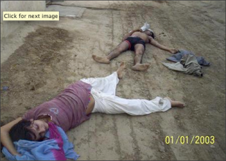 """The bodies of Sunita Devi (L), 21, and her partner Jasbir Singh, 22, lie on the ground after they were killed by villagers in an \""""honour killing\"""" in Ballah village in the northern Indian state of Haryana May 9, 2008. Growing economic opportunities for young people and lower castes in Haryana have made \""""love marriages\"""" more common, experts say, and the violent repression of them has risen in tandem as upper caste Jat men fight to hold on to power, status and property. REUTERS/Stringer"""