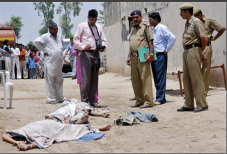 """Police look at the bodies of Sunita Devi (bottom L), 21, and her partner Jasbir Singh, 22, after they were killed by villagers in an \""""honour killing\"""" in Ballah village in the northern Indian state of Haryana May 9, 2008.REUTERS/Stringer"""