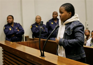 In this April 21, 2008 file photo, Tiny Virginia Makopo, 27, who faces 13 charges of indecent assault, assault and criminal injury committed against at least six students aged 13-15 and a 23-year-old at Oprah Winfrey\'s South African school for disadvantaged girls, appears in front of the judge in Sebokeng\'s court, South Africa. The former dormitory matron is going on trial Tuesday, July 29, 2008. (AP Photo/Jerome Delay, file)