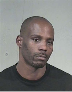In this Saturday, July 19, 2008 booking photo provided by the Maricopa County Sheriff\'s Office, rapper DMX, whose real name is Earl Simmons, is shown. The 37-year-old was arrested at a Phoenix mall Saturday on suspicion that he gave a gave a false name and Social Security number to a hospital to get out of paying for medical expenses. (AP Photo/Maricopa County Sheriff\'s Office) .