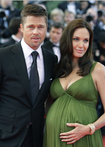 """n this May 15, 2008 file photo, American actors Brad Pitt and Angelina Jolie arrive for the premiere of the film """"Kung Fu Panda,"""" during the 61st International film festival in Cannes, southern France. People magazine has scored the U.S. rights to exclusive photos of Brad Pitt and Angelina Jolie's newborn twins, a representative for the magazine told The Associated Press on Friday. (AP Photo/Matt Sayles, file)"""