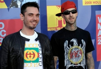 "Musician Travis Barker, right, and Adam Goldberg ""DJ AM "" arrive at the 2008 MTV Video Music Awards held at Paramount Pictures Studio Lot on Sunday, Sept. 7, 2008, in Los Angeles. (AP Photo/Chris Pizzello)"
