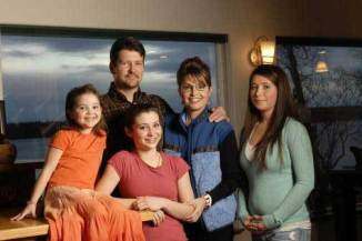 The Palin family with daughter Bristol with a peculiar bump that has many saying she was pregnant.