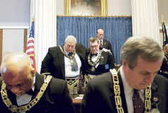 Milton 'Toby' Fitch, left, and David Cash sign the resolution officially recognizing each other's Masonic organizations, putting an end to 138 years of disregard. Members of the black lodge had voted for recognition four years ago. Members of the white lodge agreed in September.