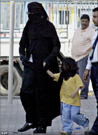 Michael Jackson, pictured here wearing a traditional Arab women's veil in Bahrain in 2006, is said to have become a Muslim.