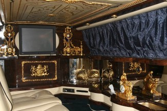 Inside MJ's Rolls-Royce with 24k gold embellishment, leather and rich walnu