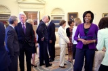 President Barack Obama, background, and First Lady Michelle Obama greet guests in the Oval Office April 21, 2009, including former President Bill Clinton, U.S. Senator Edward M. Kennedy, former first lady Rosalynn Carter, center, along with Vice President Joe Biden.