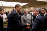 President Barack Obama greets Costa Rica President Oscar Arias during a reception at the Summit of the Americas in Port of Spain, Trinidad on April 17, 2009