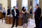 President Barack Obama jokes with senior advisors Mona Sutphen and David Axelrod during a birthday party April 15, 2009, for senior advisor Pete Rouse. Oval Office