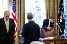 President Barack Obama makes phone calls from the Oval Office with Chief of Staff Rahm Emanuel and Assistant to the President for Legislative Affairs Phil Schiliro present 4/24/09.