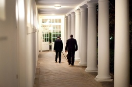 """President Barack Obama leaves the Oval Office at night, walking with family dog, """"Bo,"""" on the Colonnade toward the Residence 4/24/09"""