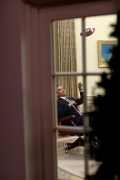 President Barack Obama plays with a football in the Oval Office 4/23/09.